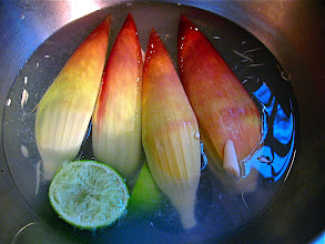 Photo: cut and trimmed banana blossom soaking in water with lime juice to keep from discoloring