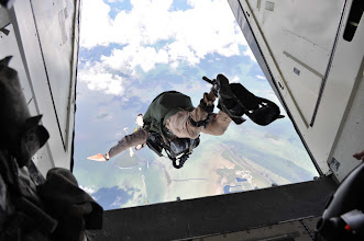 Photo: A cadre member assigned to the Advanced Tactical Infiltration Course at the Military Freefall School exits an aircraft in order to conduct a high-altitude, high-opening airborne operation Nov. 2, 2010 into the ocean off the coast of Key West, Fla. (Courtesy photo)