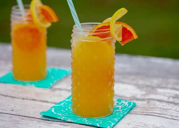 Orange Lemonade Poured Over Ice With An Orange Slice Garnish.
