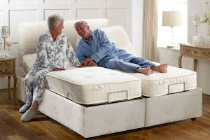 a couple on a linked adjustable bed