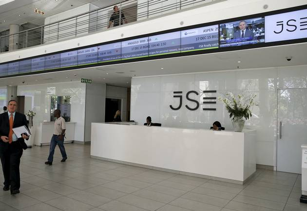 People walk near the reception at the Johannesburg Stock Exchange (JSE) in Sandton, Johannesburg.