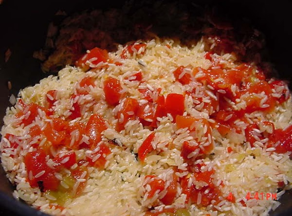 Use a medium heavy pot with a tight fitting lid to make this rice....