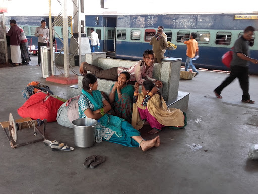 A family staying entertained while waiting for a train