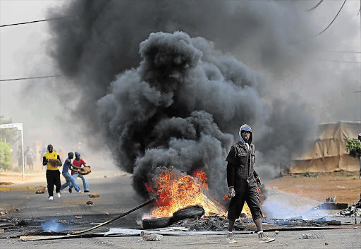 A violent service-delivery protest in Bekkersdal on the West Rand almost spiralled out of control as stone-throwing demonstrators clashed with police. Seven people were arrested after a community centre was burnt down.