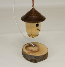 "Photo: Bob Browning 2 1/2"" x 3"" bird house ornament [walnut, birch]"