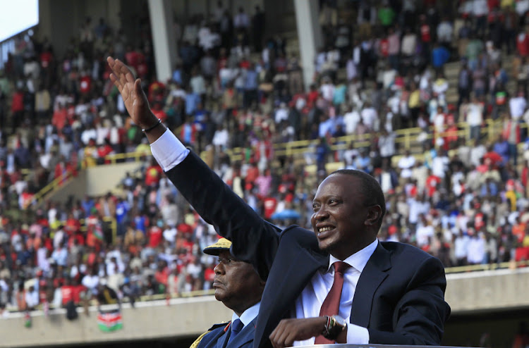 Kenyan President Uhuru Kenyatta waves as he leaves after his swearing-in ceremony in Nairobi in April. Picture: REUTERS