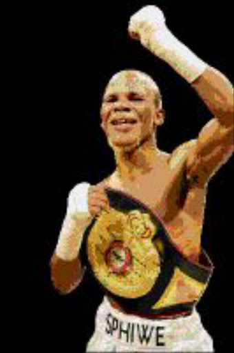 Simphiwe Nongqayi the champion celebrate after beating Julio Ler the challenger during their fight WBF World Super Flyweight title fight for 12 round. Simhpiwe won the on points. Pic:  Tsheko Kabasia. Circa August 2009. © Sowetan.