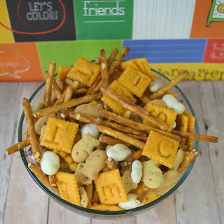 While munching this back to school snack mix you can spell out your name or create a game with the cheese crackers! Build a tower with the pretzels and cranberries! There no end to the ways you can enjoy this snack mix! Back To School Snack Mix