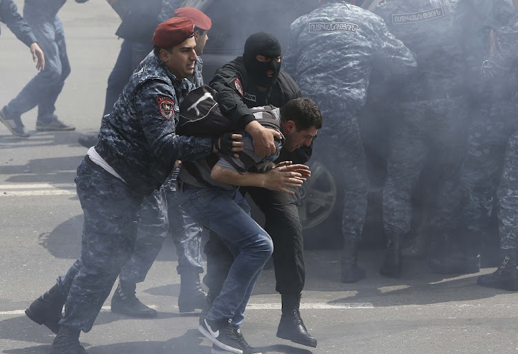 Police detain a man in Yerevan, Armenia, April 22 2018. Picture: REUTERS