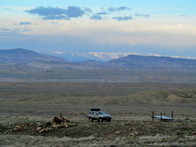 The Jeep with snow-covered Wasatch Plateau on the horizon