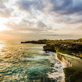 Sunset at Devil's Tear. by Michael Tan - Landscapes Sunsets & Sunrises ( clouds, bali, sky, cliffs, waves, sunset, sea, seaside, indonesa, sun )