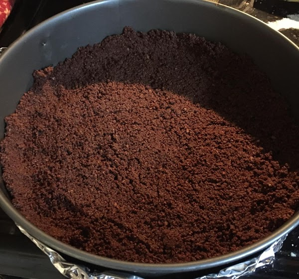 Mix Graham cracker crumbs with cocoa and sugar.  Pour melted butter over crumbs....