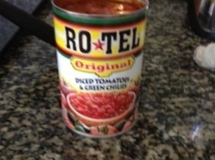 Put the entire contents of the can of diced tomatoes and green chilies into...