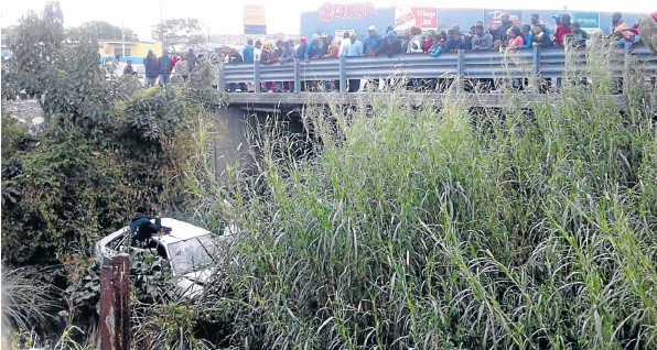 LUCKY ESCAPE: A car plunged into a river near Pefferville Primary School in East London on Wednesday.
