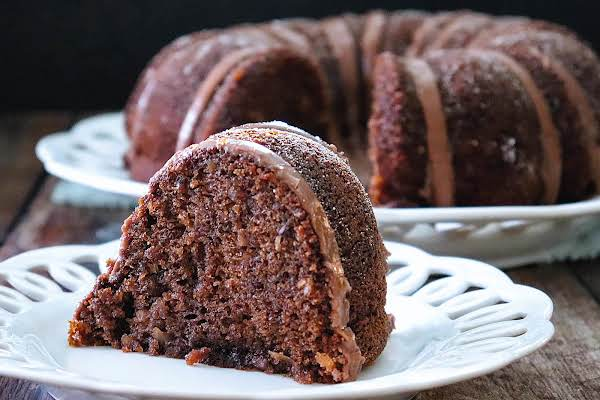 Slice Of Inside-out German Chocolate Bundt Cake On A Plate.