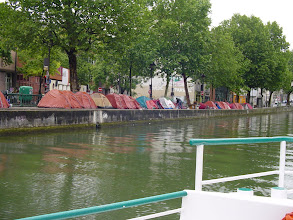 Photo: A tent city along the Canal - some look temporary, some more permanent. Madame says that she will be adding this to her letter to Sarkozy suggesting various improvements around the city ...