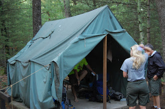 Photo: The storm brought a stick to Mr. James and Mr. Dahle's tent, which left two holes over the Scoutmaster's bunk