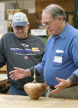 Photo: Mike explains to Chuck about how he got to the final shape.
