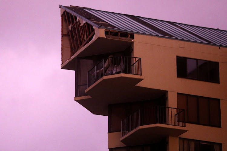 The top section of a high-rise block of flats damaged by Hurricane Michael in Florida, US.