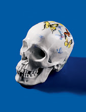 """Photo: PORZELLAN MANUFAKTUR NYMPHENBURG """"Memento Mori"""" porcelain skull with hand- painted butterfly decoration. 5″ high x 6.25″ long. Limited edition of 25. $8,100. Germany. Seventh Floor. 212 872 2686"""