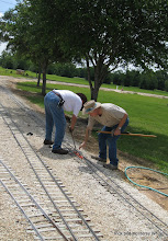 Photo: Doug Blodgett and Phillip Bell leveling the 4.75 inch gauge track.  HALS-SLWS 2009-0522