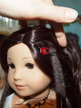 Photo: To attach the dreads to your doll, lift up the top layer of hair and attach the hair clip.