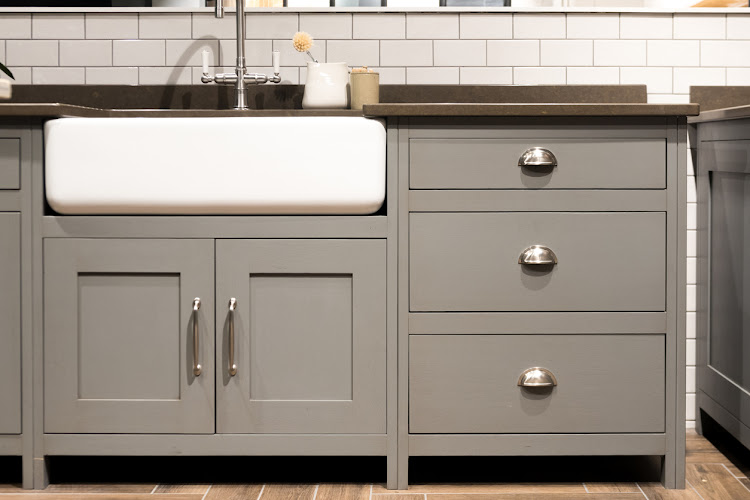 Give your kitchen a modern new look by giving the units a coat of dark paint.