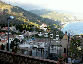 Photo: The cable car ascends 162 metres to Taormina town from the lido