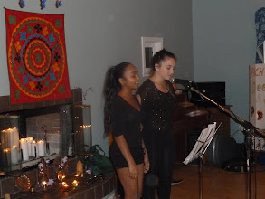 Photo: Mel and Aurora singing.jpg