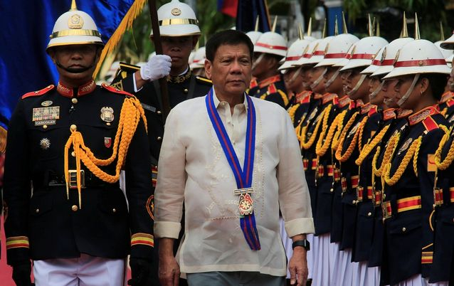 Philippines President Rodrigo Duterte reviews the honour guard upon arrival to the PNP Assumption of Command Ceremony at police headquarters in Manila, Philippines in July. Picture: REUTERS