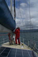 Photo: Mate putting up the staysail