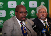 A file photo of former Cricket South Africa president Chris Nenzani (L) addressing the media on December 7 2019 in Johannesburg - a day after the suspension of chief executive Thabang Moroe - as vice-president Beresford Williams (R) listens attentively.