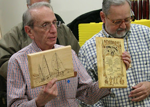 Photo: Guest Alan Pechnea with two woodburned plaques.