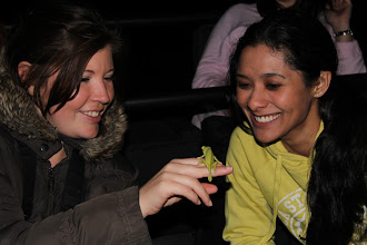 Photo: Mary and Jehan with a chameleon the guide spotted during their night game drive.