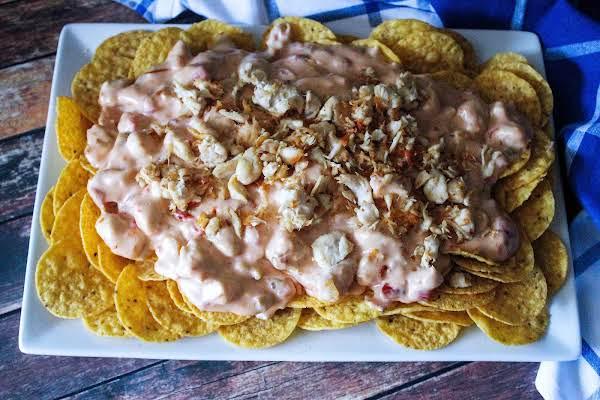 A Platter Filled With Chicken Cheese Nachos.