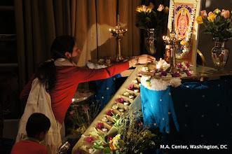 Photo: Vandana putting petals at Ayyappa's feet during Ayyappa's Ashtothara