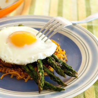 Roasted Asparagus and Sweet Potato Hash Brown topped with a Fried Egg