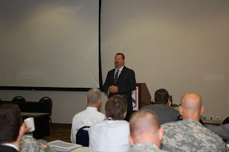 Photo: Dr. George Reed, Associate Dean and faculty member in the School of Leadership and Education Sciences at the University of San Diego, makes a presentation about ethics and leadership to attendees at the 2014 Fort Leavenworth Ethics Symposium.