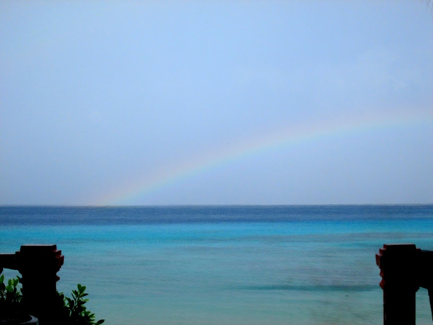 A rainbow in the middle of the ocean.