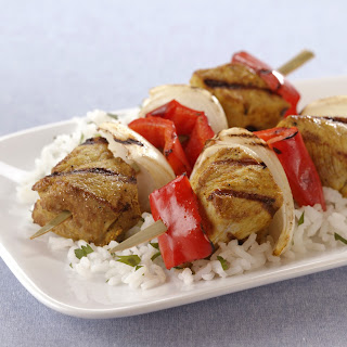 Grilled Indian Pork Kabobs with Sweet Onions and Red Bell Peppers.