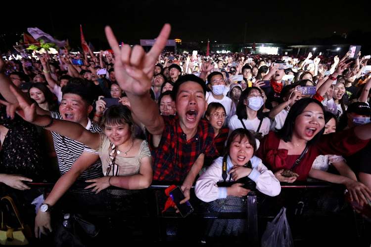 Fans attend a performance of a rock band at the Strawberry Music Festival during Labour Day holiday in Wuhan, Hubei Province, China, on May 1 2021.