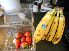 Photo: Strawberries and bananas ready to blend (we rinsed the strawberries and left the stems on to help them stay fresh,)