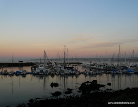 Photo: Sunset and low tide at Monterey Harbor.