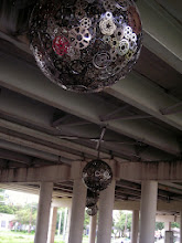 """Photo: """"Ballroom Luminoso"""" by Blessing Hancock and Joe O'Connell, under Interstate 35. See http://www.jbpublicart.com/portfolio/ballroom_luminoso for a night-time photo that shows the lighting and shadows."""