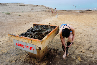 Photo: Making good use of the free mud at the Dead Sea Spa