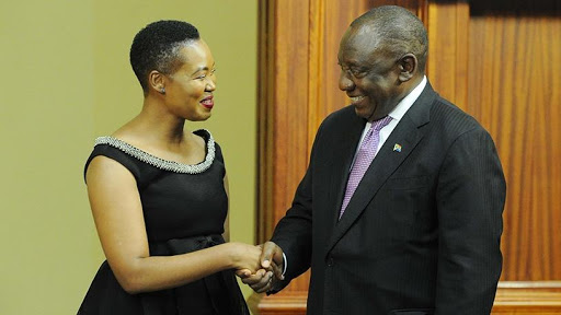 President Cyril Ramaphosa shakes hands with Stella Ndabeni-Abrahams after her appointment as communications minister.