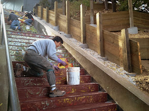 Photo: Thirteenth full day of work (Sunday, November 13, 2013): KZ Tile workers continued on site through the weekend to complete grouting of the Hidden Garden Steps (16th Avenue, between Kirkham and Lawton streets in San Francisco's Inner Sunset District) 148-step ceramic-tile mosaic designed and created by project artists Aileen Barr and Colette Crutcher. For more information about this volunteer-driven community-based project supported by the San Francisco Parks Alliance, the San Francisco Department of Public Works Street Parks Program, and hundreds of individual donors, please visit our website at http://hiddengardensteps.org.