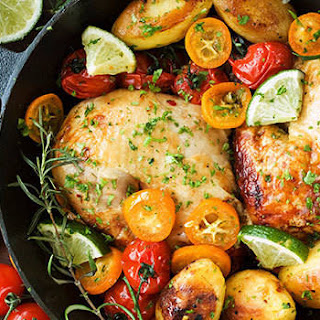 Roast Chicken Quarters with Potatoes and Tomatoes.