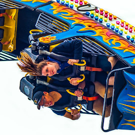 by Garry Dosa - City,  Street & Park  Amusement Parks ( exhilerating, fast, outdoors, action, fair, rides, people, ride, fun, speed,  )