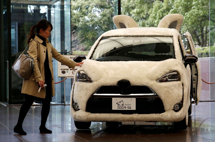 A Toyota car decorated as a dog at the company's headquarters in Tokyo, Japan. Picture: REUTERS/KIM KYUNG-HOON
